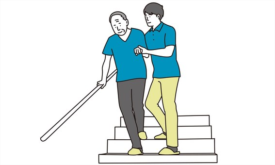 Elderly people going down the stairs with assistance