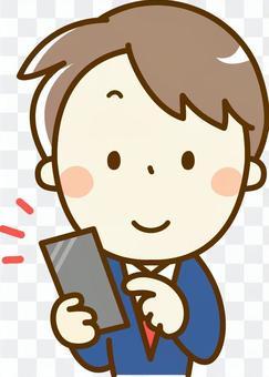 男學生經營一個智能手機