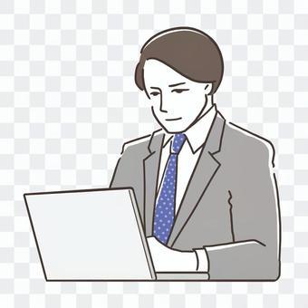 ノートPCと男性