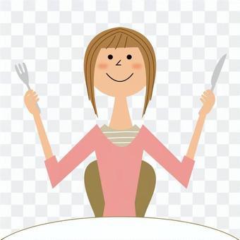 一個女人用刀和叉子