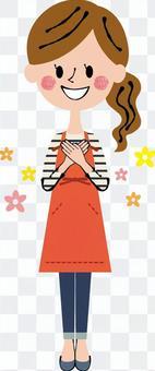 雙手在胸部的女性全身手幸福的圍裙