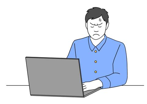 一個在電腦上工作時生氣的人-藍色