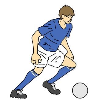 Men's soccer player dribbling