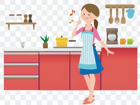 一個女人站在廚房裡