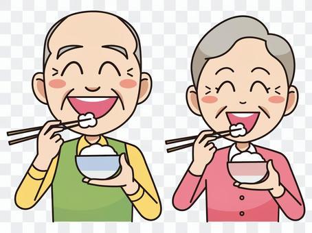 吃米饭的老年夫妇