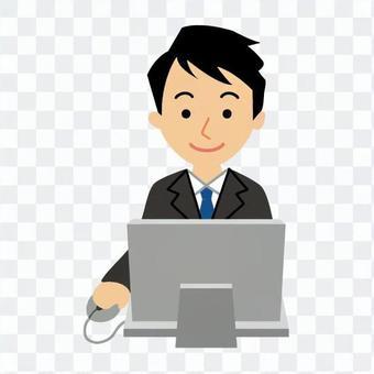男子誰在電腦上工作