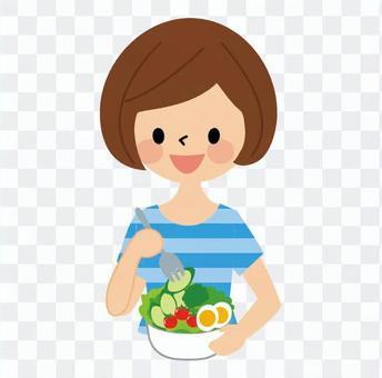 A woman eating a salad