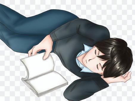 一個男人躺著看書