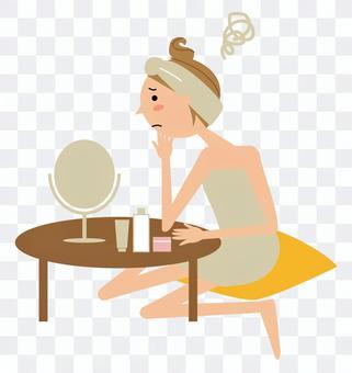 一個女人坐在鏡子前擔心