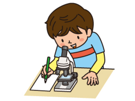 A boy watching a microscope