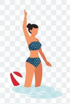 舉起她的右手的泳裝女人