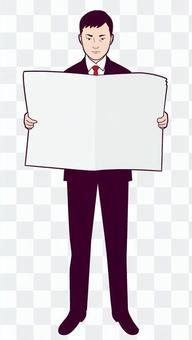 閱讀一份報紙的商人