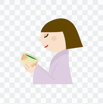 A woman who drinks green tea