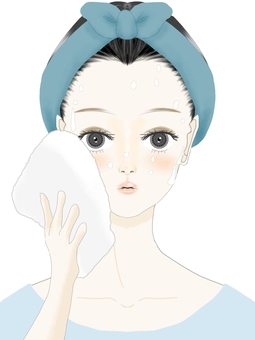 Woman wiping her face with a towel