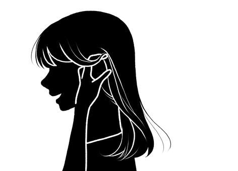 一個女人做手勢把頭髮放在耳朵上