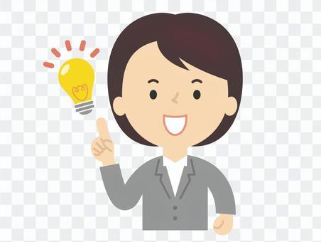 アイデアがひらめくスーツの女性 電球
