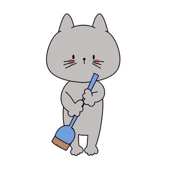 拿著掃帚的貓