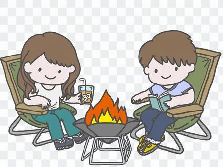 Men and women enjoying camping