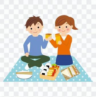 A couple enjoying a picnic