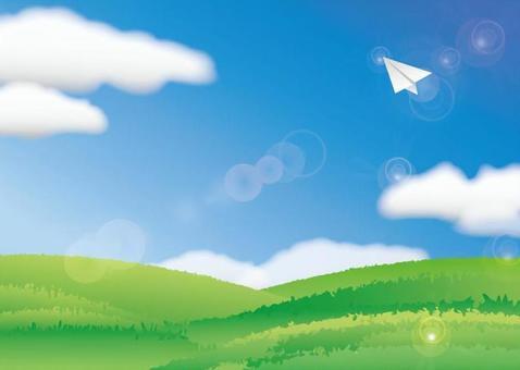 高原上有一架紙飛機和藍天的風景