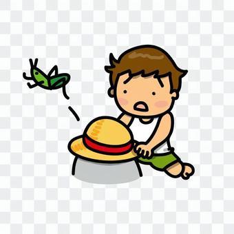 A boy trying to grab a grasshopper