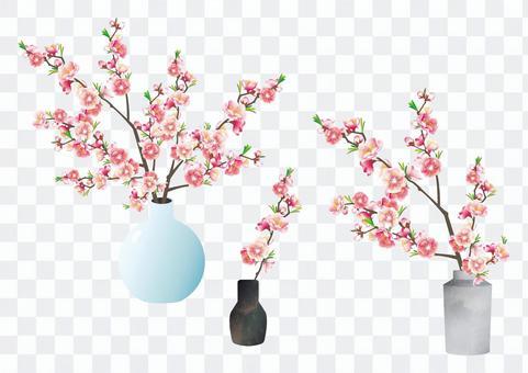 花瓶に活けた枝付きの花桃