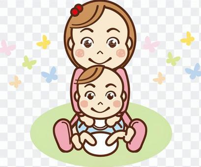 抱著一個嬰兒的女孩