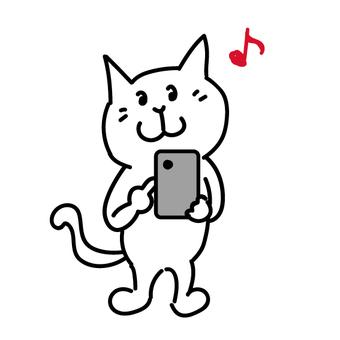 貓觸摸智能手機的屏幕