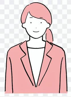 A woman in a simple suit with a smile
