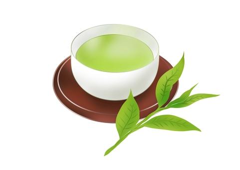 Warm green tea and tea leaves