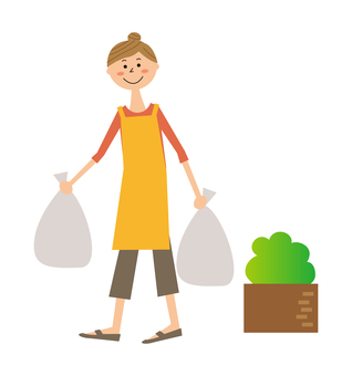 A woman carrying two trash bags