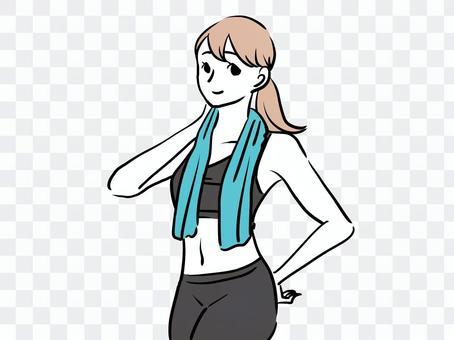 一個在健身房完成訓練並擦乾汗水的女人