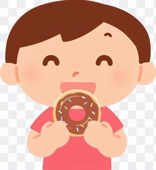 男孩吃甜甜圈