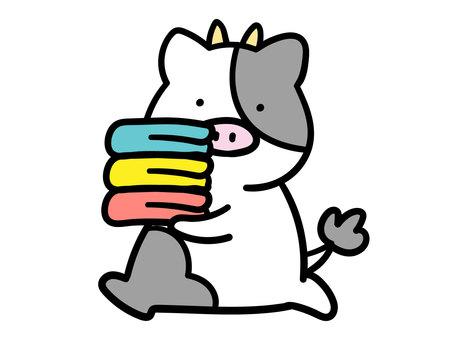 一頭牛背著毛巾的插圖