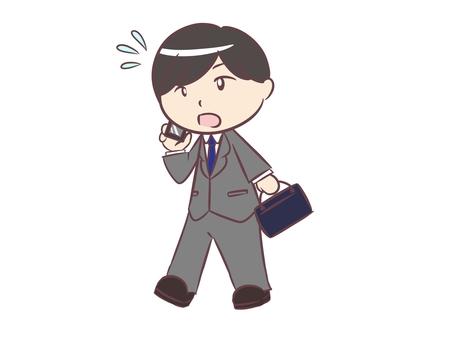 A businessman walking while making a phone call