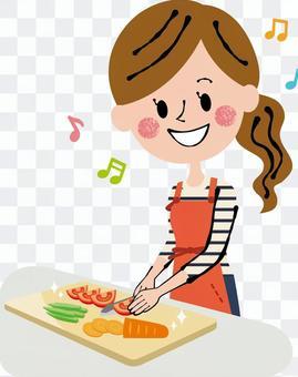 烹飪切菜的婦女