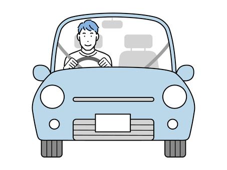 駕駛汽車的年輕人
