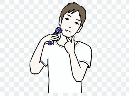 一個男人用電動剃須刀剃須
