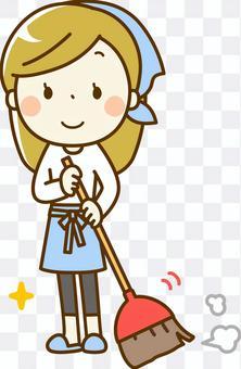 一個女人用掃帚掃地