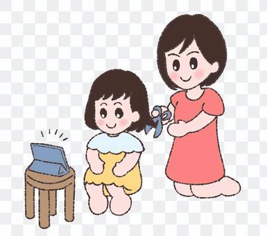 散髪する親子