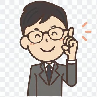 A man with glasses eyed glasses that teaches points with a smile