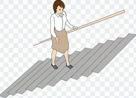 手摺りを持って階段を上がる女性