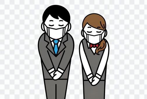 マスク姿でお礼をする男性と女性の会社員
