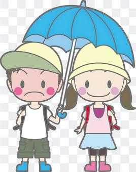 Boys and girls playing an umbrella