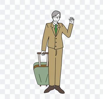 キャリーバッグを引いて手を振る父親