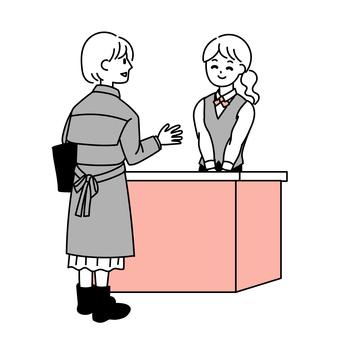 一位女士與接待員交談