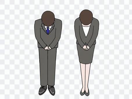 一位穿著西裝的銀行職員深深地鞠了一躬