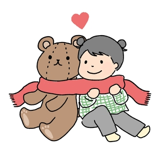 Girl wearing a teddy bear and a muffler