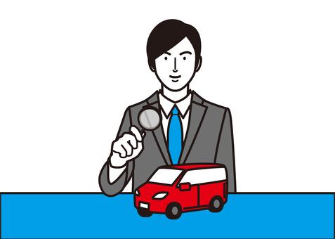 一個有汽車和放大鏡的商人