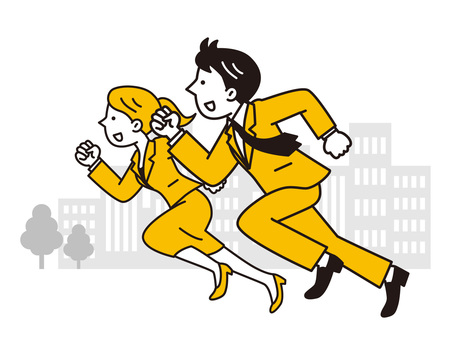 Male and female businessmen running in the building area